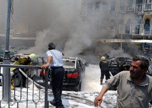 A picture released by the official Syrian news agency SANA shows men at the scene after two huge bombs exploded outside the Palace of Justice in Central Damascus on June 28, 2012 (AFP PHOTO/SANA)