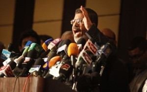 Mohamed Morsi, FJP Chairman and presidential candidate addresses a meeting of coalition partners against SCAF rule (AFP)
