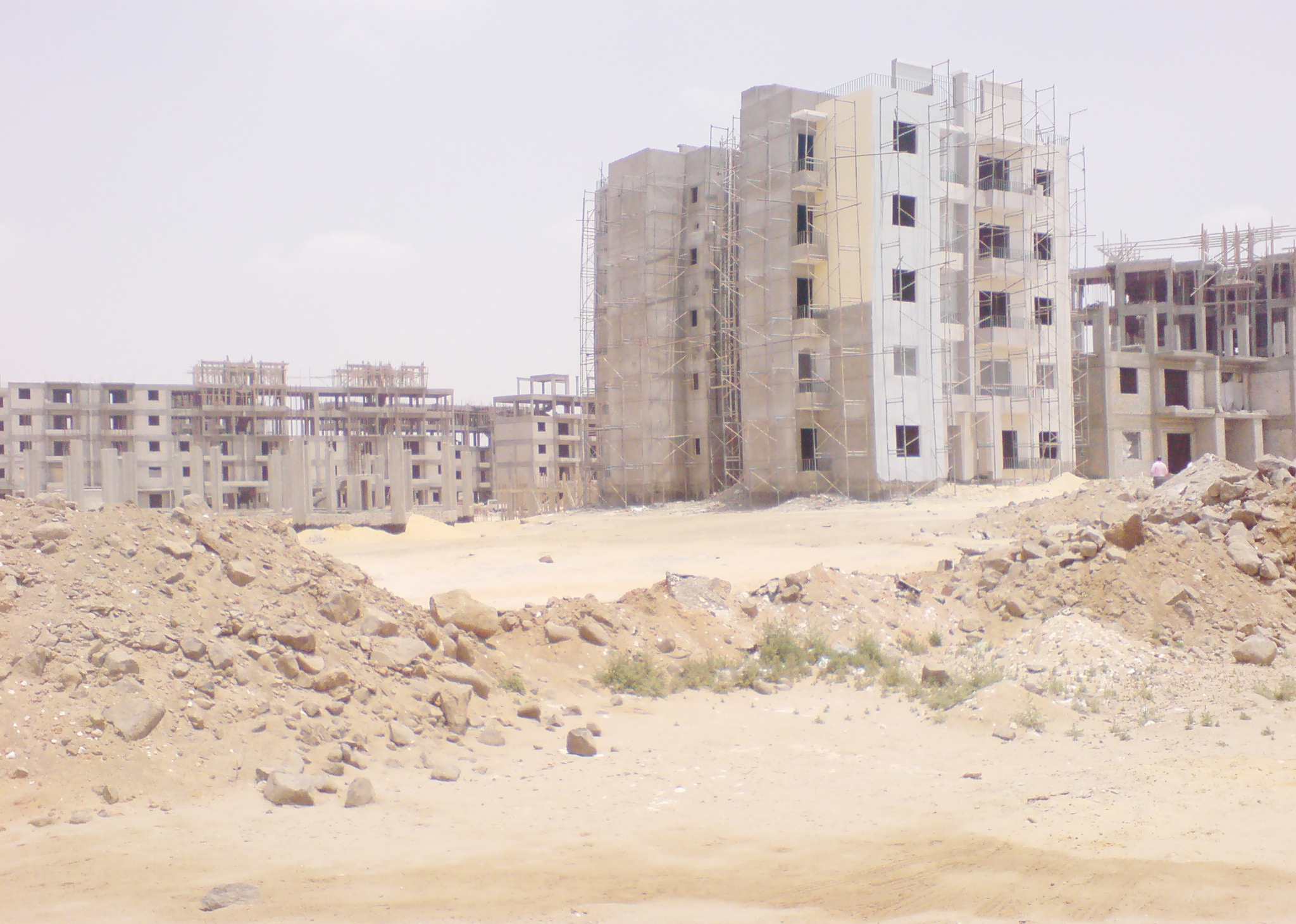 The Ministry of Housing froze all standing housing projects, including the second phase of a plan to build one million units and another Central Agency for Construction plan for 50,000 units in the provinces