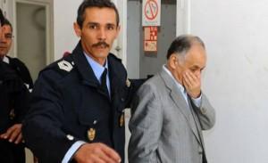 Former Libyan prime minister Baghdadi al-Mahmoudi (R) was arrested in Tunisia last September. (AFP)