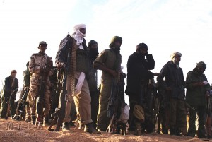 "A handout picture released by the Mouvement national pour la libération de l'Azawad (Azawad National Liberation Movement - MLNA) on April 2, 2012 and taken in February 2012 reportedly shows MNLA fighters gathering in an undisclosed location in Mali. Islamist and Tuareg rebels clashed in the key town of Gao in Mali's occupied north, leaving at least 20 people dead, witnesses said on June 27, 2012. "" RESTRICTED TO EDITORIAL USE - MANDATORY CREDIT ""AFP PHOTO / MNLA ""- NO MARKETING NO ADVERTISING CAMPAIGNS - DISTRIBUTED AS A SERVICE TO CLIENTS"