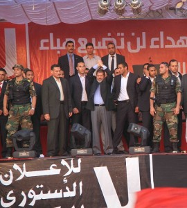 President-elect Morsi swears oath of office from atop stage in Tahrir Square. (Photo by Mohamed Omar)