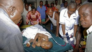 A child injured by an explosion at a bar in the Mishomoroni district of Mombasa. AFP Photo
