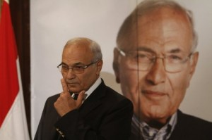 """Former presidential hopeful Ahmed Shafik addresses a news conference on 3 June saying, """"No one will be detained for their opinion... Security services will be committed to the law and to human rights standards"""" PHOTO/AFP"""