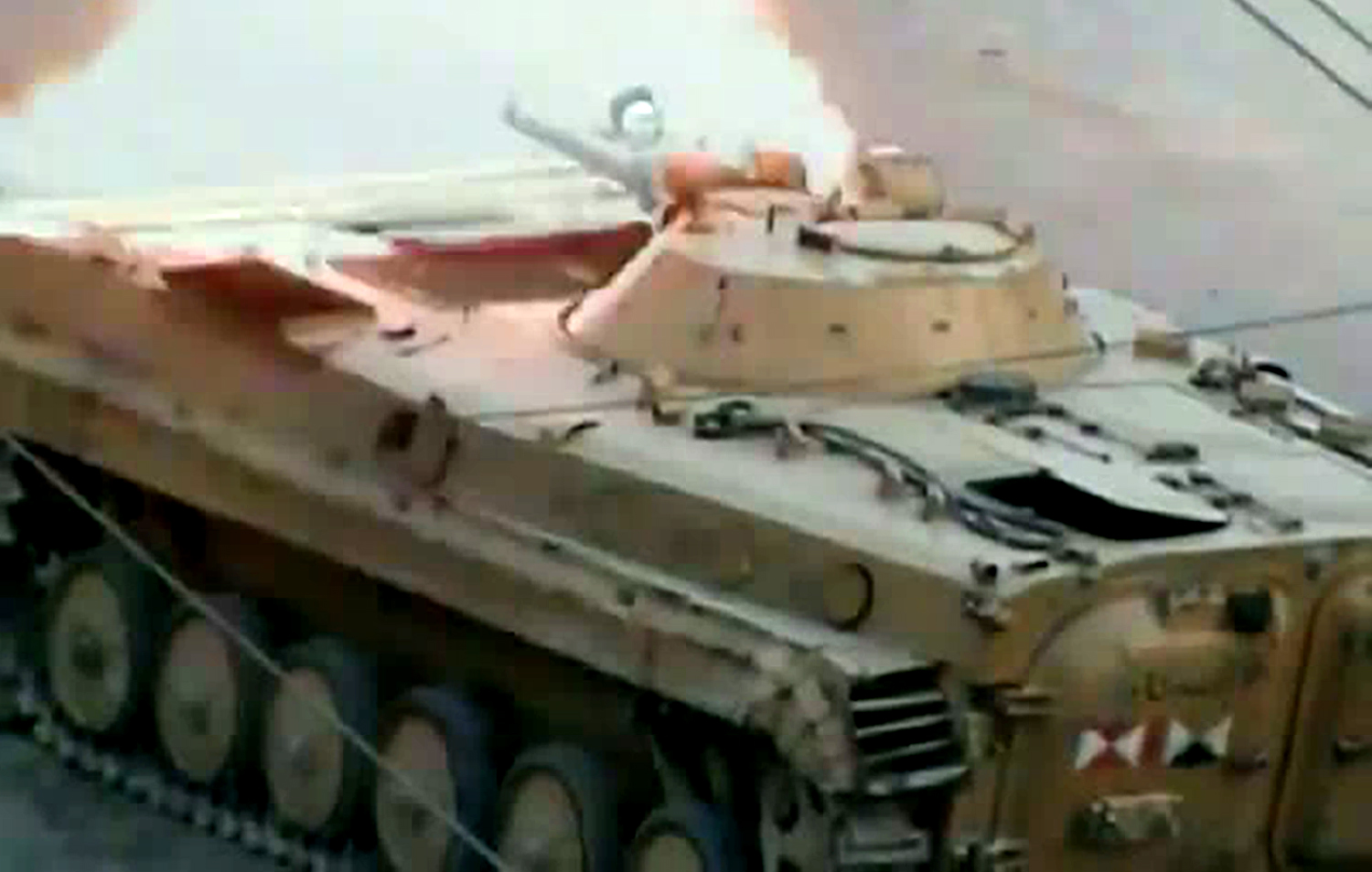 An image grab taken from a video uploaded on YouTube on July 17, 2012 allegedly shows a tank from forces loyal to Syria's President Bashar al-Assad firing a round in the city of Saqba, in Damascus province. AFP PHOTO/YOUTUBE