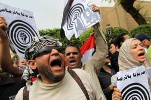 Activists from the April 6 Youth Movement shout anti-government slogans in downtown Cairo (Photo: KHALED DESOUKI/AFP)