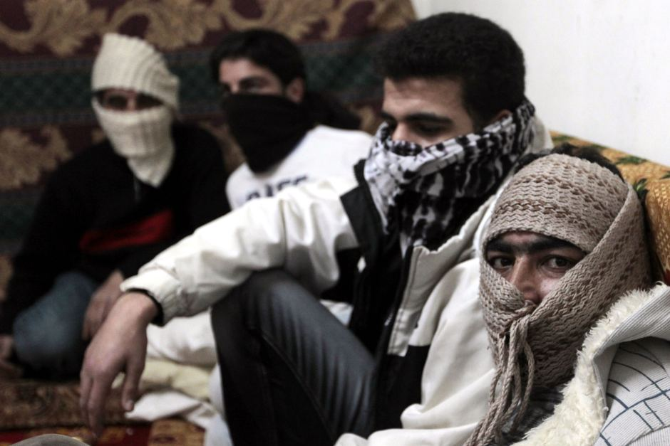 Syrian refugees from Damascus sit in a flat in Amman (AFP/Khalil Mazraawi)