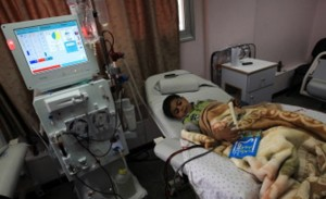 The Gaza city hospital that provides this boy with dialysis will soon be relying on Egypt's energy grid for their shortages, despite shortfalls there as well (photo: AFP)