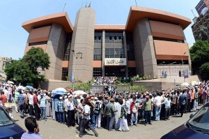Crowd gather outside the Administrative Judiciary Court in Cairo where a critical ruling on Tuesday may result in the dissolution of the Constituent Assembly (photo: Mohamed Omar)