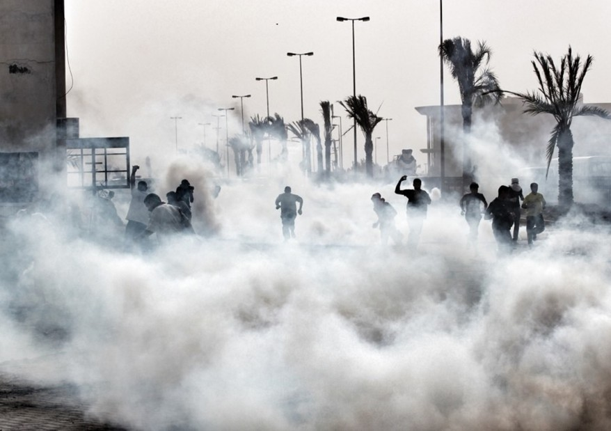 A handout picture released by Bahrain's main opposition Al-Wefaq group shows protesters engulfed in tear gas fired by police during a demonstration in a Shia village close to Manama (file photo: AFP/Ho/Al-Wefaq Media Centre)
