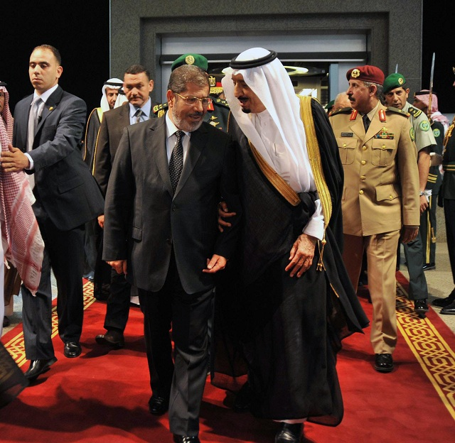 A picture released by the Egyptian Presidency shows Saudi Arabia Crown Prince Salman Bin Abdulaziz al-Saud (R) greeting Egyptian President Mohamed Morsy upon his arrival in Jeddah on 11 July (AFP PHOTO / AHMED FUAD)
