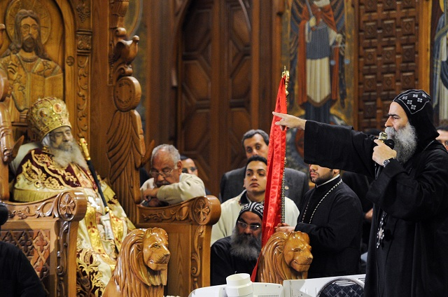 Body of Coptic Christian Pope Shenouda III lies in state at St Marks cathedral in Cairo as worshippers walk past to pay their final respects (File photo: Laurence Underhill)