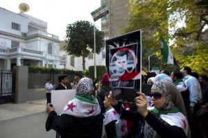 Protesters outside the Syrian embassy in Cairo plan to continue to pressure against the government in Syria (photo AFP/ODD ANDERSEN)