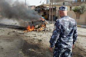 An Iraqi security officer arrives on the scene at a bombing in Iraq (AFP/file)
