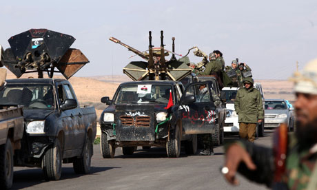 Former Libyan rebel fighters mass at the al-Estada settlement, 30 miles from Bani Walid (File photo, AFp / Mahmud Turkia)