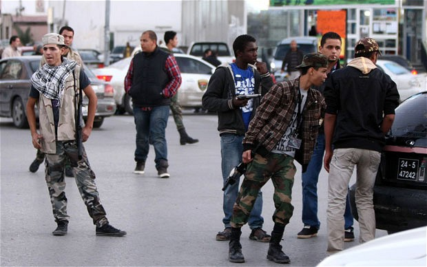 Militia members man a checkpoint in Tripoli. A top-level commander was recently shot at by militiamen in Libya (AFP/file)
