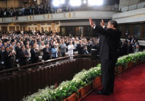 President Morsy addresses the crowd before his speech at Cairo University (AFP)