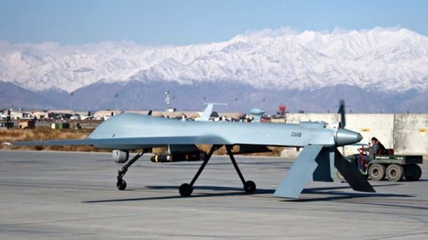 A US surveillance drone sits on the runway (photo: AFP)