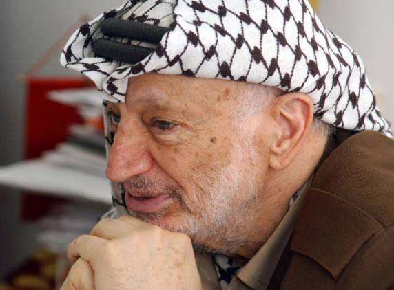 Palestinian leader Yasser Arafat at his office in the West Bank city of Ramallah (AFP file photo)