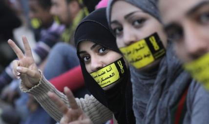 Protesters have been pressuring President Morsy to use his presidential powers to free thousands of civilians tried in military courts in Egypt (photo: AFP)