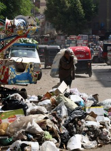 A man rummages through a pile of garbage in Cairo (file photo: AFP /CRIS BOURONCLE)