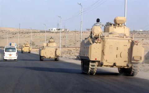 A convoy of Egyptian armoured vehicles head along a road in El-Arish on the Sinai Peninsula on the way to the city of Rafah near the Gaza border (File photo AFP)