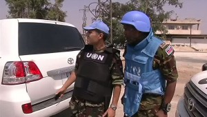 : An image grab taken from a video released by the United Nations Supervision Mission in Syria (UNSMIS) shows members of the UN Supervision Mission in Syria during a tour of the central Syrian cities of Homs and Rastan on 29 July 2012 (photo: AFP / HO / UNSMIS)