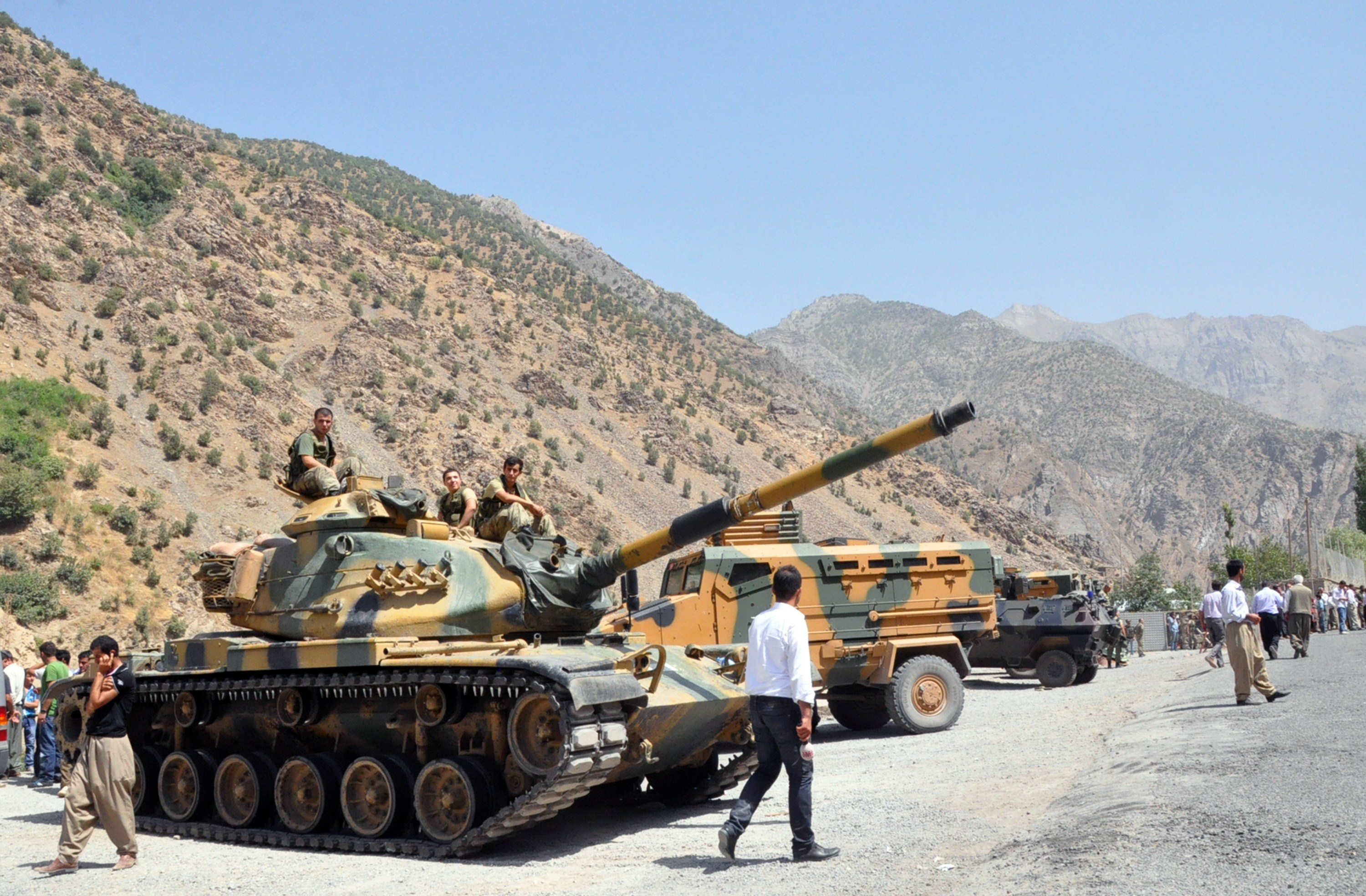Heavy armoured vehicles of Turkish military are stationed in front of Gecimli military outpost where Kurdish rebels attacked and killed 6 soldiers and 2 village guard on 5 August AFP PHOTO/STR