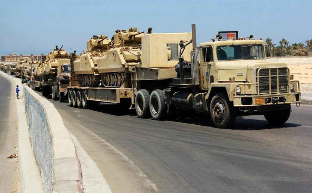 Tanks are transported into North Sinai near the border between Egypt and Gaza