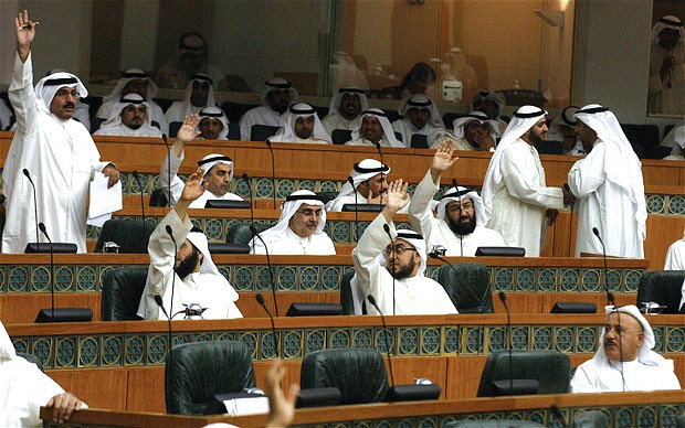 Kuwaiti MPs raise their hands during a parliament session at the National Assembly in Kuwait City (AFP PHOTO)