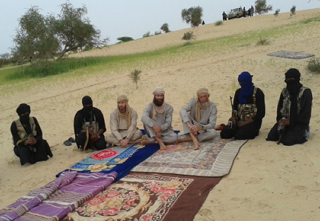 An image from Al-Jazeera television broadcast on 21 August shows three Western hostages taken captive in northern Mali almost nine months ago by Ansar Dine, just one of several Islamist groups including MUJAO and Al-Qaeda in the Islamic Maghreb AFP PHOTO / AL-JAZEERA / HO