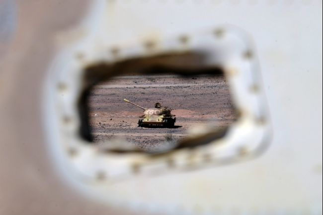 The wreckage of a Morrocan tank is pictured near the Western Sahara village of Tifariti in the region where the Frente Polisario is fighting for independence for the territory on the west African coast AFP PHOTO / Dominique Faget