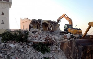 Libyan Islamist hardliners use a bulldozer to raze the mausoleum of Al-Shaab Al-Dahman near the centre of Tripoli on 25 August AFP PHOTO / MAHMUD TURKIA