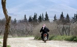 A man rides his motorbike in Joura in Lebanon's Bekaa valley in the area where the Kuwaiti engineer was allegedly kidnapped AFP PHOTO