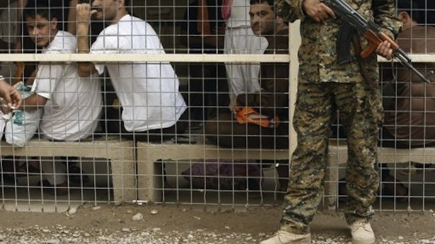 20120829_CJM_Death Penalty_CAM Prison officer guards detainees in an Iraqi prison AFP PHOTO / SABAH ARAR