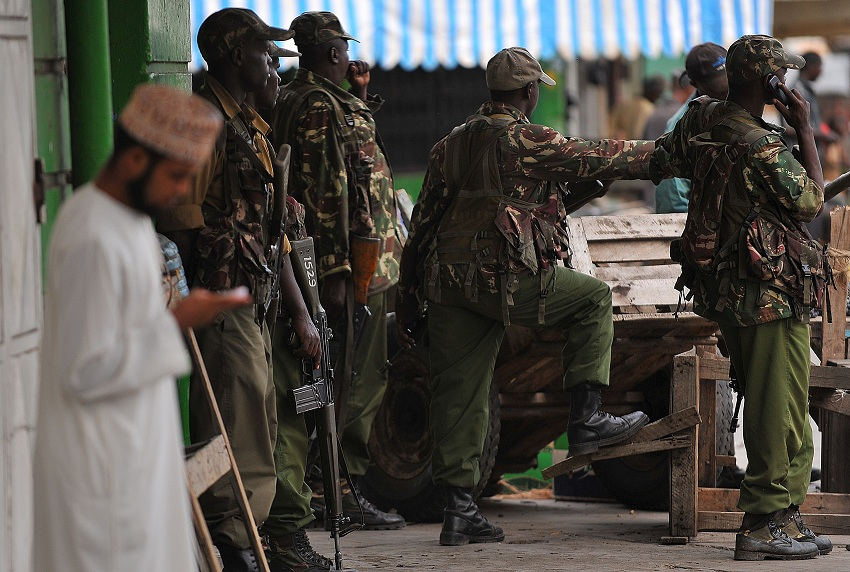 Police officers stand guard in the coastal city of Mombasa on 29 August following two days of deadly rioting AFP PHOTO / SIMON MAINA