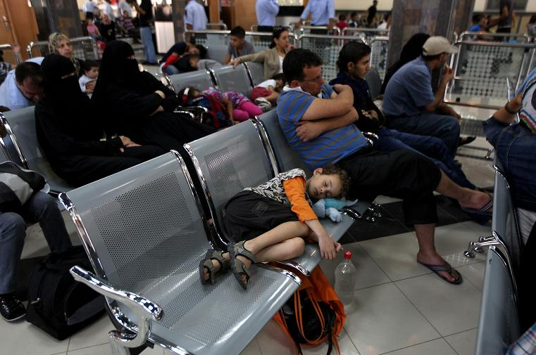 Palestinians wait in a hall at the Rafah border crossing in the southern Gaza Strip before travelling to Egypt AFP PHOTO/ SAID KHATIB