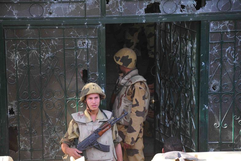 Egyptian Army soldiers secure the Israeli Embassy in Giza after it was stored by protesters in September 2011 Hassan Ibrahim