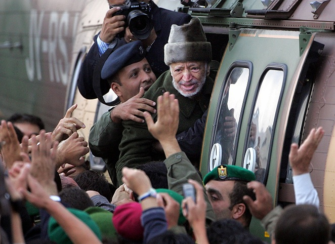 Ailing Palestinian leader Yasser Arafat saying goodbye to well-wishers as he boards a Jordanian army helicopter on 29 October 29 en route to Paris to seek medical treatment AFP PHOTO/ODD ANDERSEN