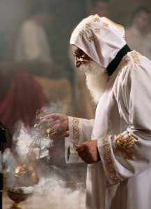 An Egyptian Copt monk burns incense prior to the Coptic Easter celebration mass (File photo) AFP PHOTO / CRIS BOURONCLE