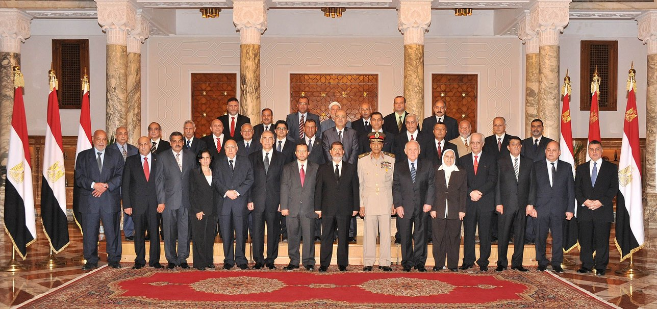 A handout image made available by the Egyptian presidency on August 2, 2012, shows Egyptian President Mohammed Morsy (8th L) following the swearing in ceremony of the new Egyptian cabinet at the presidential palace in Cairo (photo: AFP PHOTO/EGYPTIAN PRESIDENCY)