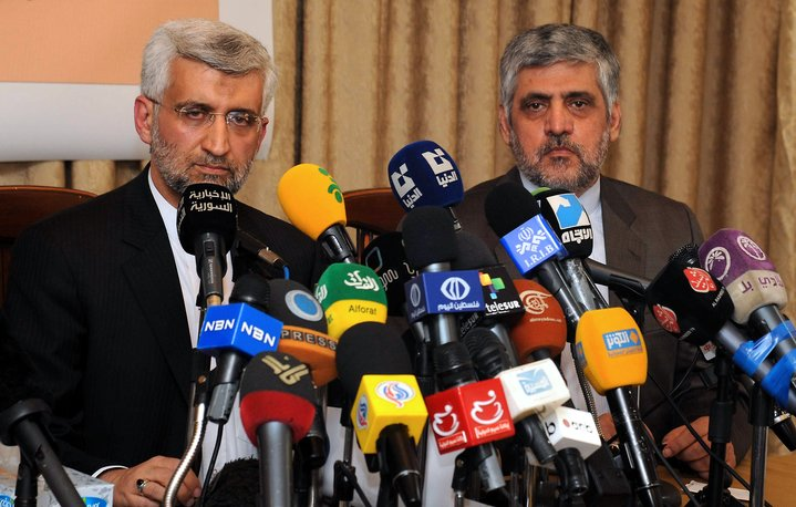 Saeed Jalili, head of Iran's supreme national defence council, holds a joint press conference with Iranian ambassador to Syria Mohammad Reza Sheibani (L) at the Iranian embassy in the Syrian capital Damascus on 7 August (AFP PHOTO/STR)