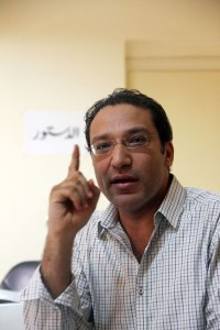 Islam Afifi, editor of Egyptian El-Dostour newspaper, gesturing during a meeting at the newspaper's offices in Cairo on 13 August AFP PHOTO/STR
