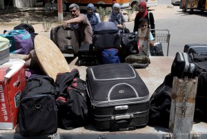 Palestinians load their luggage onto the back of a pick-up truck at the Rafah border on 14 August after Egypt reopened the crossing for limited numbers AFP PHOTO / SAID KHATIB
