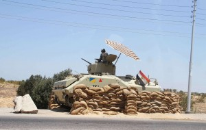 An Egyptian army vehicle keeps its position close to the Rafah border crossing with the Hamas-run Gaza Strip on August 06, 2012. AFP PHOTO/AHMED MAHMOUD