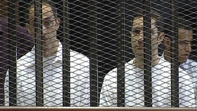 Gamal (left) and Alaa Mubarak during their trial in Cairo on 2 June 2012 (File photo) AFP