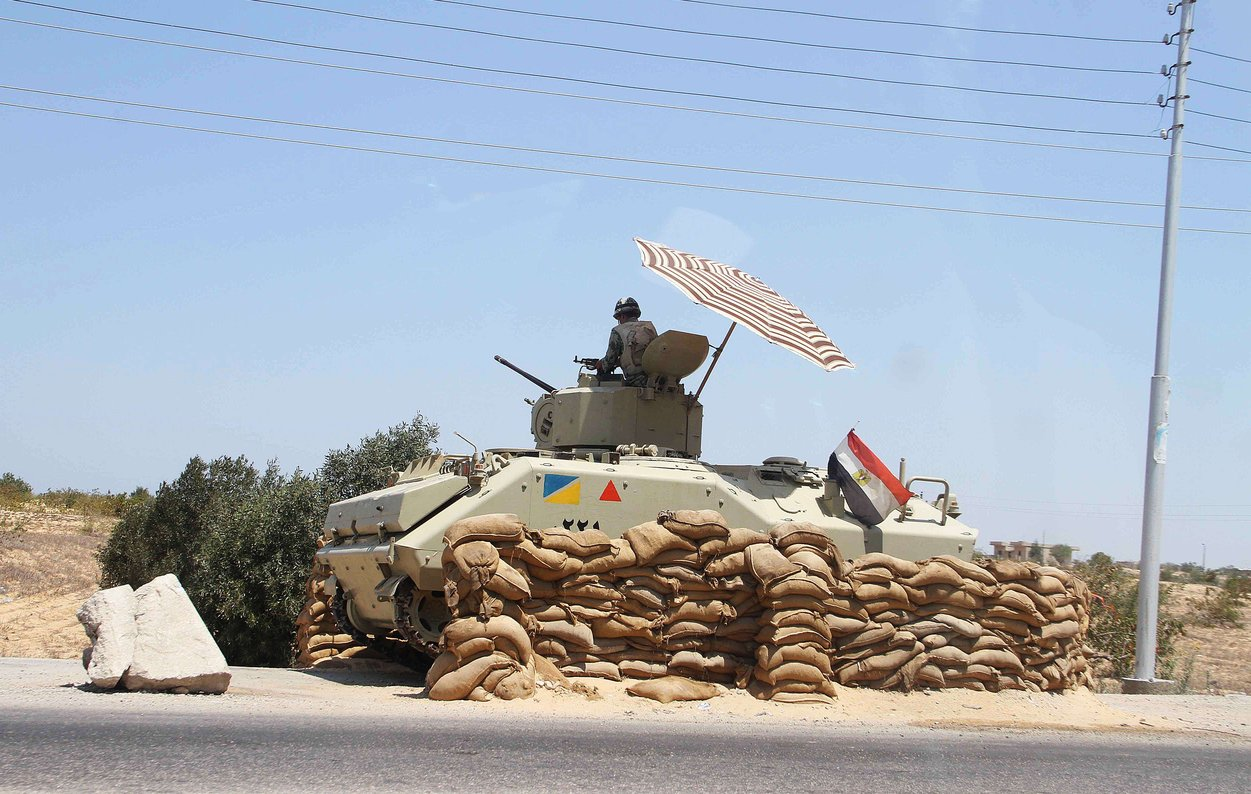 An Egyptian army vehicle keeps its position close to the Rafah border crossing with the Hamas-run Gaza Strip on 6 August AFP PHOTO/AHMED MAHMOUD