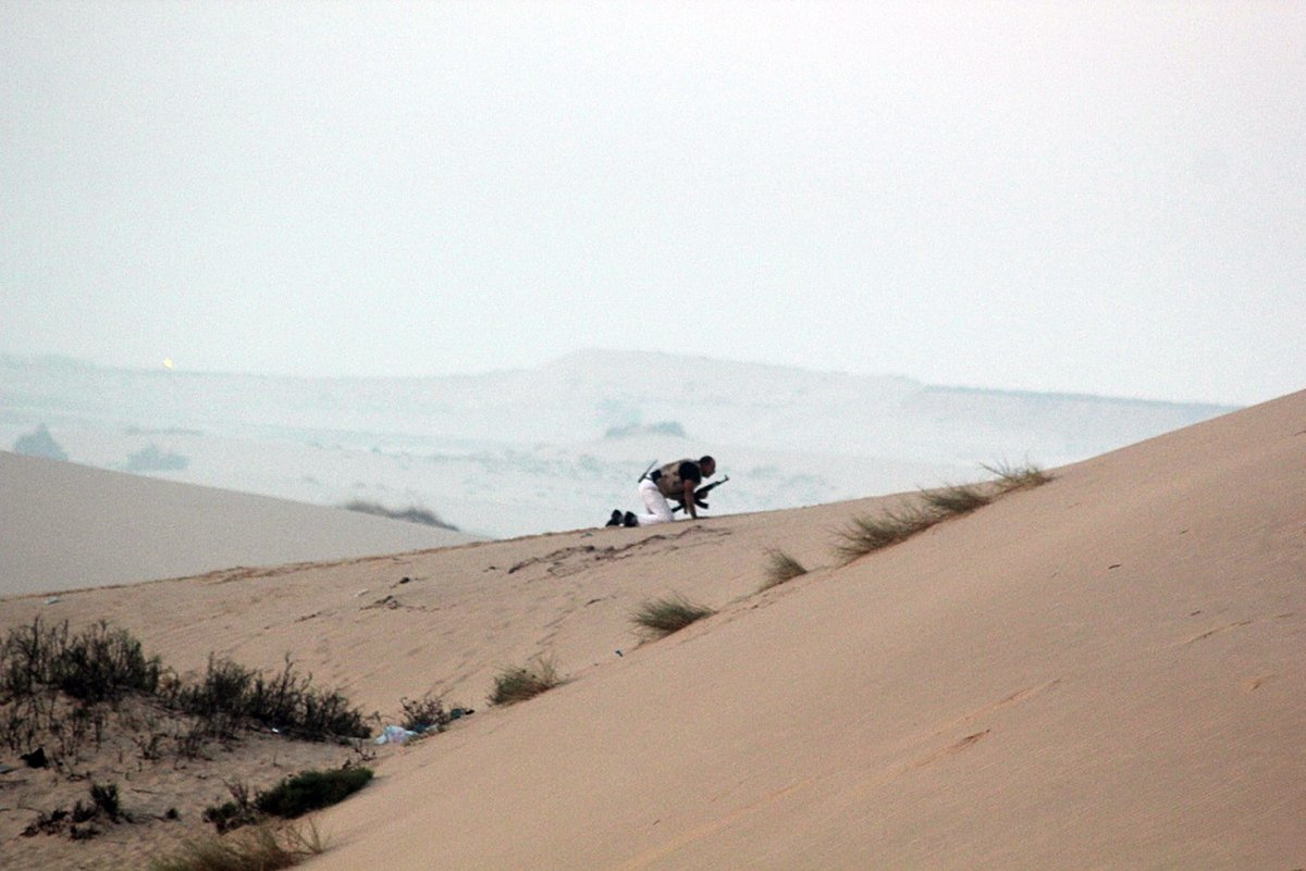 A member of the Egyptian security forces takes position on a sand dune during an operation in the northern Sinai peninsula AFP PHOTO/STRINGER