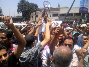 Cleopatra ceramics workers protest outside of the presidential palace on 6 July after Mohamed Morsi was declared winner of the presidential elections (Mohamed Omar )
