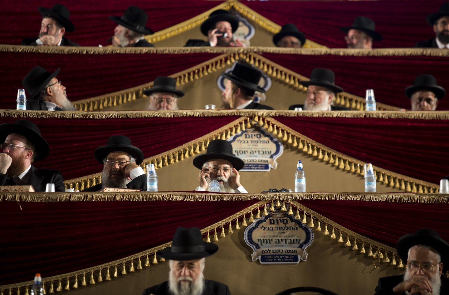 Ultra-Orthodox Jews convene at a sports stadium in Jerusalem July 30, 2012, in a celebration marking the completion of a seven-and-a-half year daily study-cycle of the entire Babylonian Talmud.Tens of thousands of Jews worldwide take part in the 'Daf Yomi' project – literally a 'daily page' of study of the ancient text of Jews law and tradition, perhaps the most central composition of rabbinic literature.AFP PHOTO/MENAHEM KAHANA